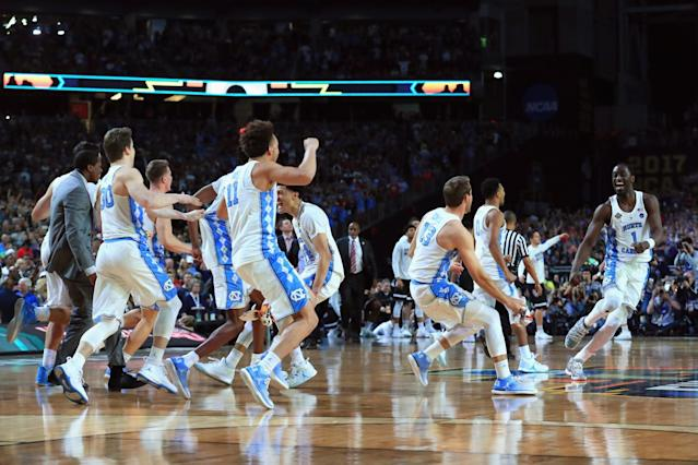 <p>Theo Pinson #1 of the North Carolina Tar Heels celebrates with teammates after defeating the Gonzaga Bulldogs during the 2017 NCAA Men's Final Four National Championship game at University of Phoenix Stadium on April 3, 2017 in Glendale, Arizona. The Tar Heels defeated the Bulldogs 71-65. (Photo by Tom Pennington/Getty Images) </p>
