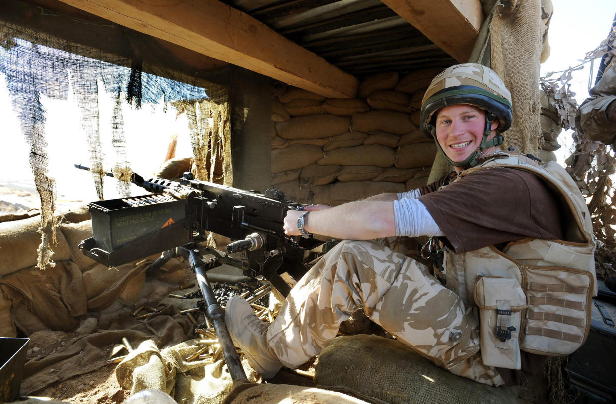 Britain's Prince Harry mans a 50 calibre machine gun on the observation post at JTAC Hill, close to FOB Delhi (forward operating base), in Helmand province, southern Afghanistan January 2, 2008. The government is reviewing Prince Harry's presence in Afghanistan, where he has been deployed with the army for 2-1/2 months, following leaks in the international media that he was deployed there, the Defence Ministry said on February 28, 2008.  Photograph taken January 2, 2008.     REUTERS/John Stillwell/Pool   (AFGHANISTAN)