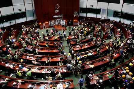 People are seen inside a chamber, after protesters broke into the Legislative Council building during the anniversary of Hong Kong's handover to China in Hong Kong