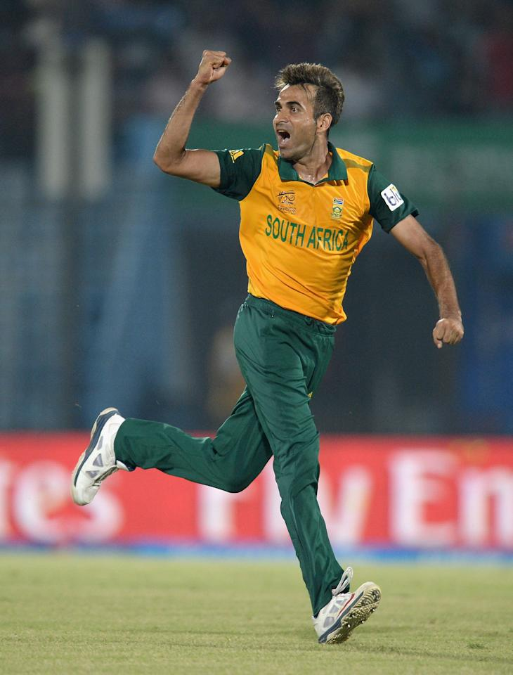 CHITTAGONG, BANGLADESH - MARCH 24:  Imran Tahir of South Africa celebrates dismissing Colin Munro of New Zealand during the ICC World Twenty20 Bangladesh 2014 Group 1 match between New Zealand and South Africa at Zahur Ahmed Chowdhury Stadium on March 24, 2014 in Chittagong, Bangladesh.  (Photo by Gareth Copley/Getty Images)