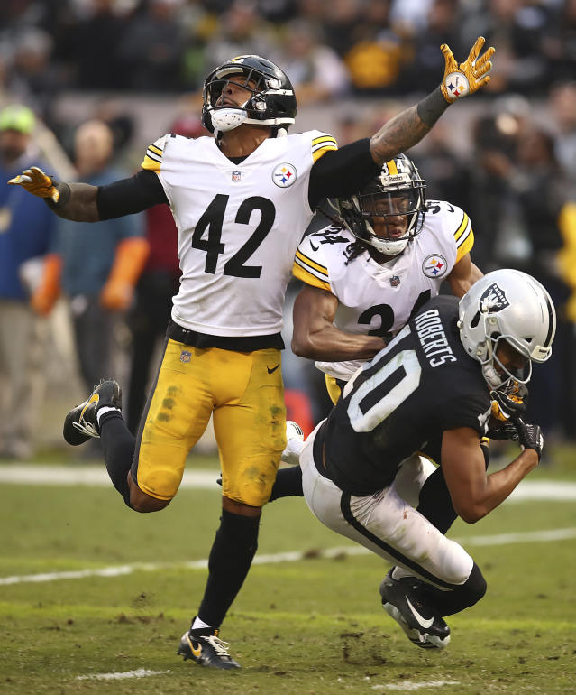 <p>Oakland Raiders wide receiver Seth Roberts (10) catches a pass in front of Pittsburgh Steelers strong safety Morgan Burnett (42) and strong safety Terrell Edmunds (34) during the second half of an NFL football game in Oakland, Calif., Sunday, Dec. 9, 2018. (AP Photo/Ben Margot) </p>