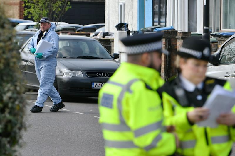 Police and forensics investigating a stabbing in Edmonton earlier this year (PA)