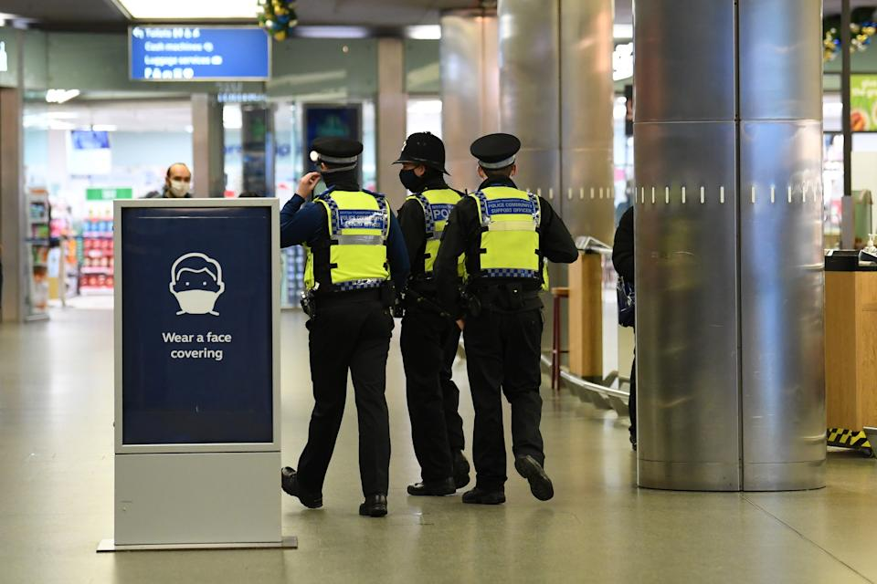 Police officers at St Pancras, London, with more being deployed to enforce travel rules at London�s stations, and the public being urged to adhere to Government guidance after Prime Minister Boris Johnson announced on Saturday that from Sunday areas in the South East currently in Tier 3 will be moved into a new Tier 4 for two weeks � effectively returning to the lockdown rules of November, after scientists warned of the rapid spread of the new variant coronavirus.