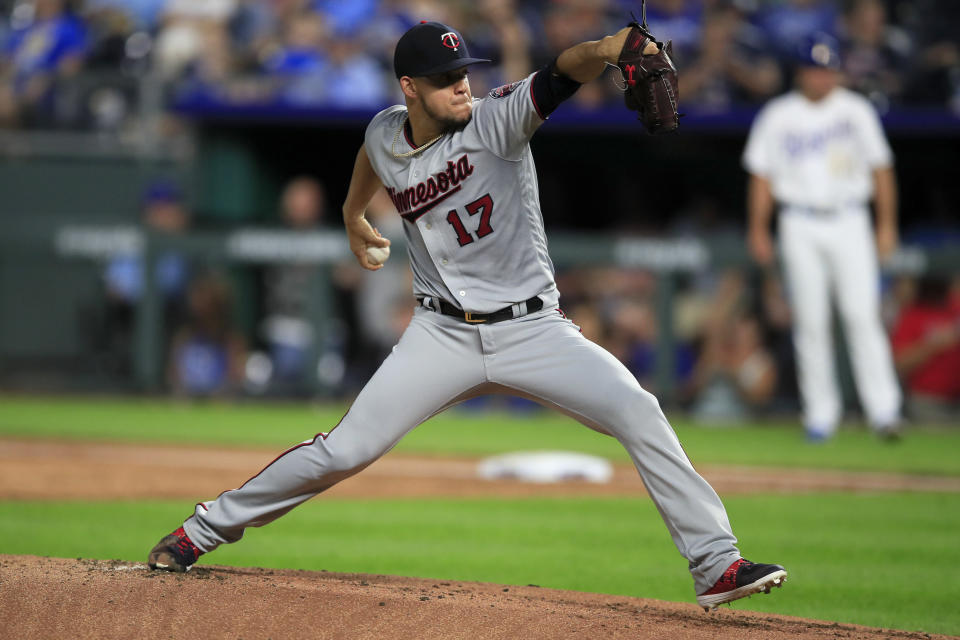 Minnesota Twins starting pitcher Jose Berrios delivers to a Kansas City Royals batter during the first inning of a baseball game at Kauffman Stadium in Kansas City, Mo., Friday, Sept. 27, 2019. (AP Photo/Orlin Wagner)
