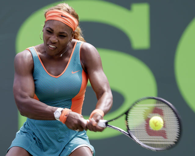 Serena Williams, of the United States, returns to Maria Sharapova, of Russia, at the Sony Open Tennis tournament in Key Biscayne, Fla., Thursday, March 27, 2014. Williams won 6-4, 6-3. (AP Photo/Alan Diaz)
