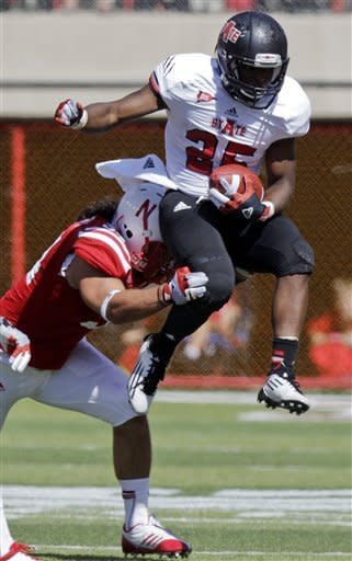 Arkansas State's David Oku (25) tries to vault Nebraska's Cameron Meredith, left, during the first half of an NCAA college football game, Saturday, Sept. 15, 2012, in Lincoln, Neb. (AP Photo/Nati Harnik)