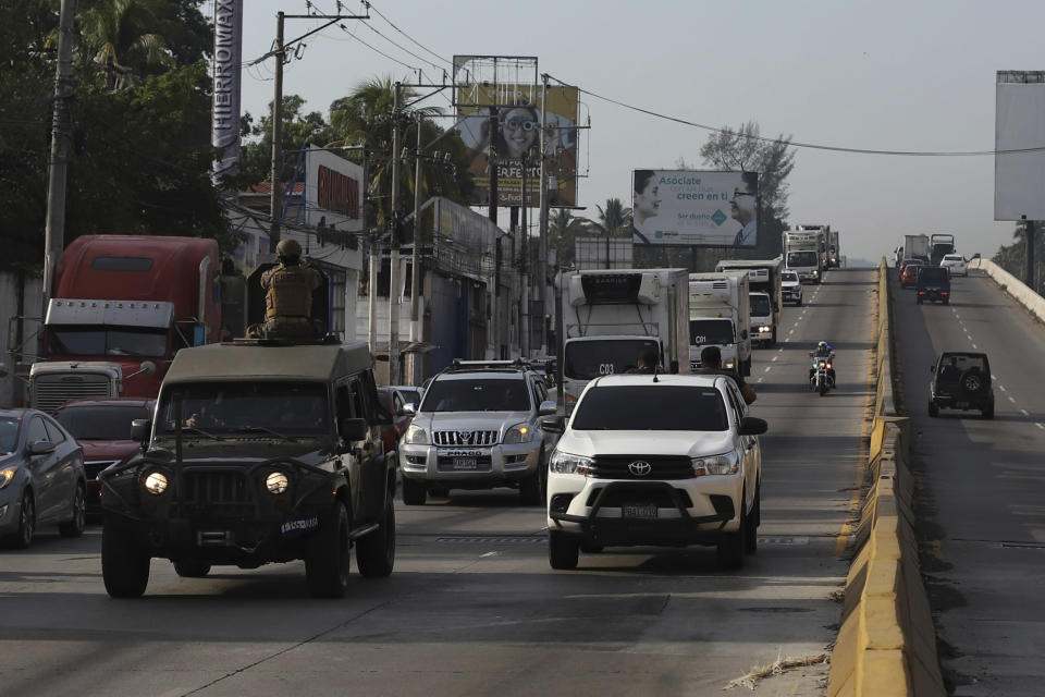 Soldiers drive ahead of Health Ministry trucks transporting COVID-19 vaccines that El Salvador's government is donating to Honduras as they depart San Salvador, El Salvador, Thursday, May 13, 2021. (AP Photo/Salvador Melendez)