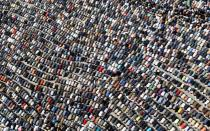 FILE PHOTO: Anti-government protesters take part in Friday prayers at Tahrir Square in Cairo