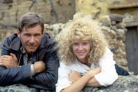 <p>Ford and Kate Capshaw on the set of <em>Indiana Jones and the Temple of Doom</em> in 1984.</p>