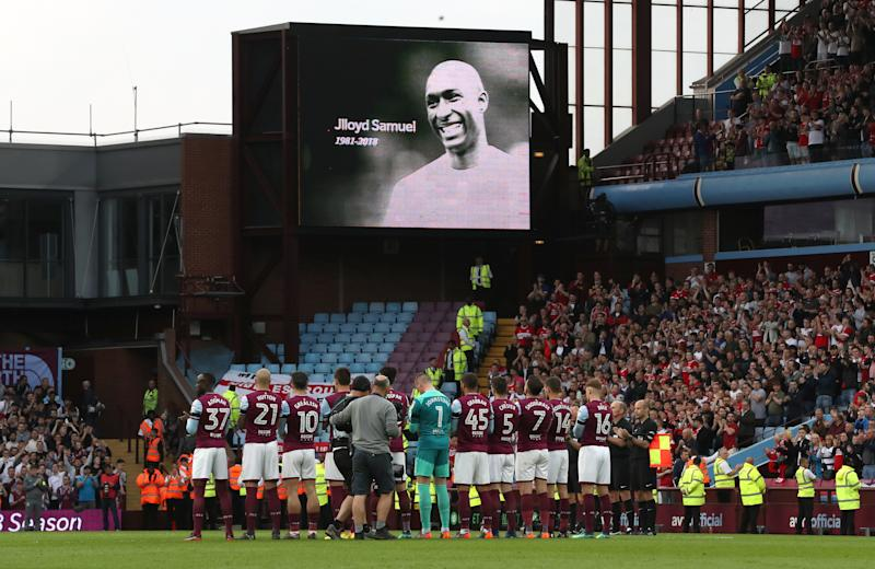 Aston villa take part in a minutes applause in memory of Jlloyd Samuel prior to the Sky Bet Championship Playoff match at Villa Park, Birmingham.