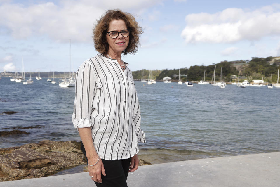 Donna Burton poses for a photo near her home in Sydney on Oct. 20, 2020. Burton had reached Sydney Airport before she was advised that Border Force had denied her an exemption to fly to London for her only daughter's wedding in July. She had made a second application for a travel exemption after the first was rejected because of a lack of supporting documentation. (AP Photo/Rick Rycroft)