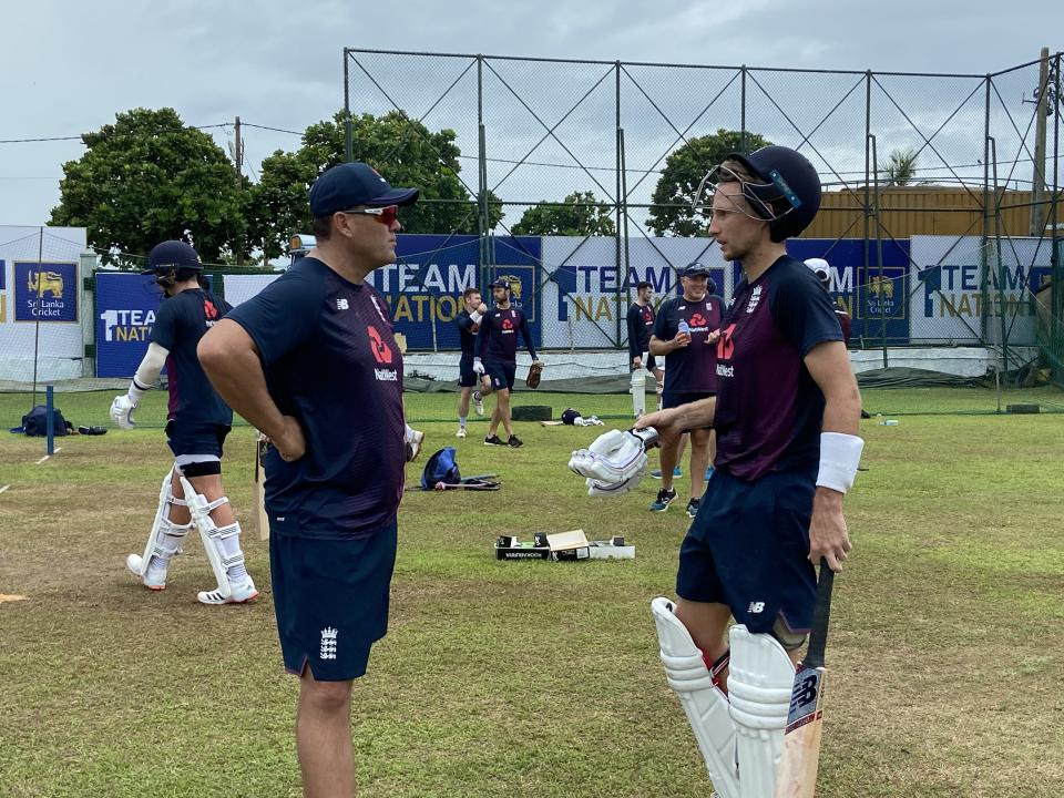 Jacques Kallis (left) shares some tips with England captain Joe Root (right)