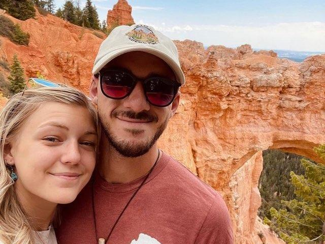 Gabby Petito and her boyfriend Brian Laundrie in a selfie in front of rock formations