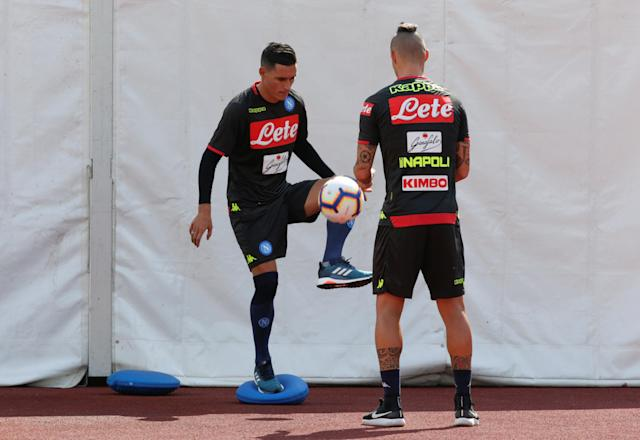 Napoli's Jose Maria Callejon and Marek Hamsik attend a training session in Dimaro, northern Italy July 11, 2018. REUTERS/Ciro De Luca