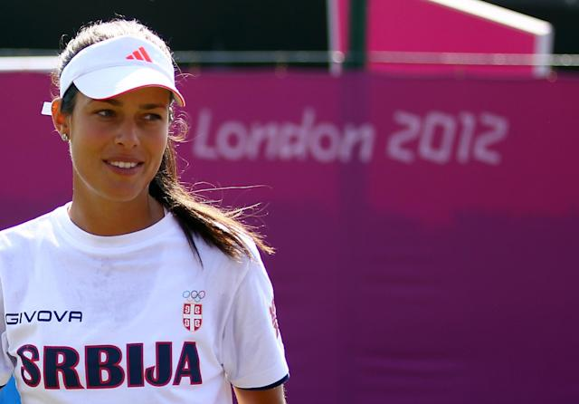 LONDON, ENGLAND - JULY 26: Ana Ivanovic of Serbia smiles during the practice session ahead of the 2012 London Olympic Games at the All England Lawn Tennis and Croquet Club in Wimbledon on July 26, 2012 in London, England. (Photo by Clive Brunskill/Getty Images)