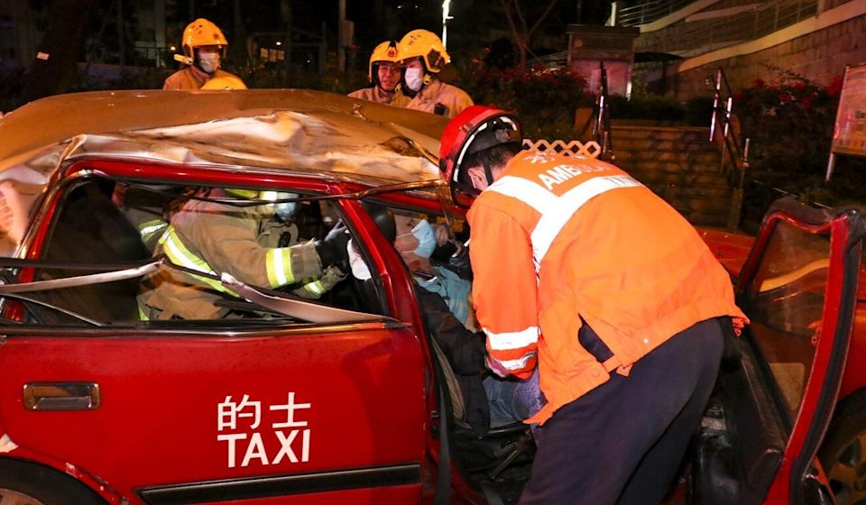 The cab driver had to be freed from his taxi. Photo: Handout