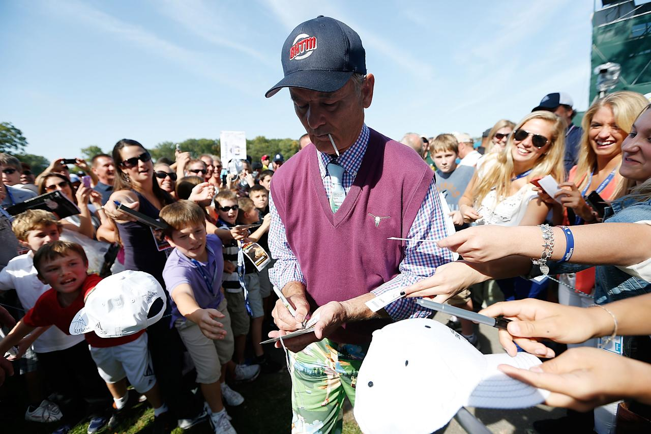 MEDINAH, IL - SEPTEMBER 25:  Hollywood star Bill Murray signs autographs for the gallery during the 2012 Ryder Cup Captains & Celebrity Scramble at Medinah Country Golf Club on September 25, 2012 in Medinah, Illinois.  (Photo by Jamie Squire/Getty Images)