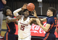 Rutgers center Myles Johnson (15) is pressured by Illinois guards Ayo Dosunmu, left, and Jacob Grandison and forward Coleman Hawkins (33) during the first half of an NCAA college basketball game Sunday, Dec. 20, 2020, in Piscataway, N.J. (AP Photo/Bill Kostroun)