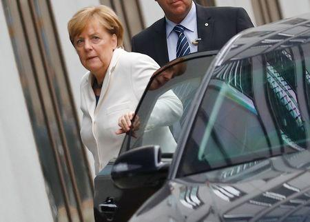 Angela Merkel, leader of the Christian Democratic Union (CDU), arrives at the German Parliamentary Society offices before the start of exploratory talks about forming a new coalition government in Berlin, Germany, October 20, 2017. REUTERS/Axel Schmidt