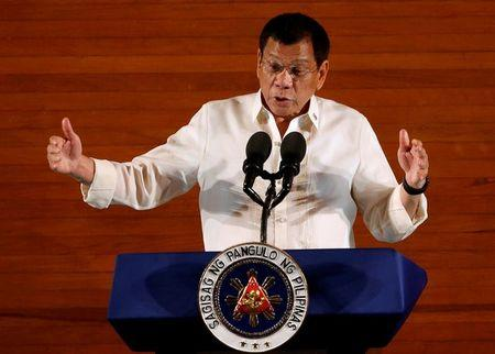 Philippine President Rodrigo Duterte gestures during his first State of the Nation Address at the Philippine Congress in Quezon city, Metro Manila, Philippines July 25, 2016. REUTERS/Erik De Castro