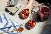 """Sangria doesn't have to be a sugary mess. Grilled stone fruit adds a natural caramelized sweetness to this refreshing drink. <a href=""""https://www.epicurious.com/recipes/food/views/grilled-stone-fruit-sangria?mbid=synd_yahoo_rss"""" rel=""""nofollow noopener"""" target=""""_blank"""" data-ylk=""""slk:See recipe."""" class=""""link rapid-noclick-resp"""">See recipe.</a>"""
