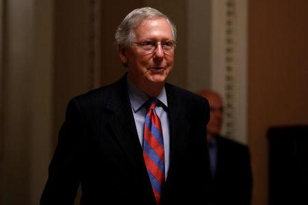 Senate Majority Leader Mitch McConnell walks to his office prior to an all night round of health care votes on Capitol Hill in Washington, U.S., July 27, 2017. REUTERS/Aaron P. Bernstein/File Photo