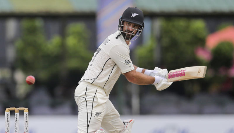 New Zealand's Colin de Grandhomme plays a shot during day four of the second test cricket match between Sri Lanka and New Zealand in Colombo, Sri Lanka, Sunday, Aug. 25, 2019. (AP Photo/Eranga Jayawardena)