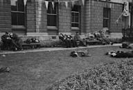 <p>Soldiers, so exhausted from the V-E Day celebrations, collapsed across a London park.</p>