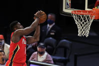 New Orleans Pelicans forward Zion Williamson (1) dunks the ball against the New York Knicks during the second half of an NBA basketball game Sunday, April 18, 2021, in New York. (AP Photo/Adam Hunger, Pool)