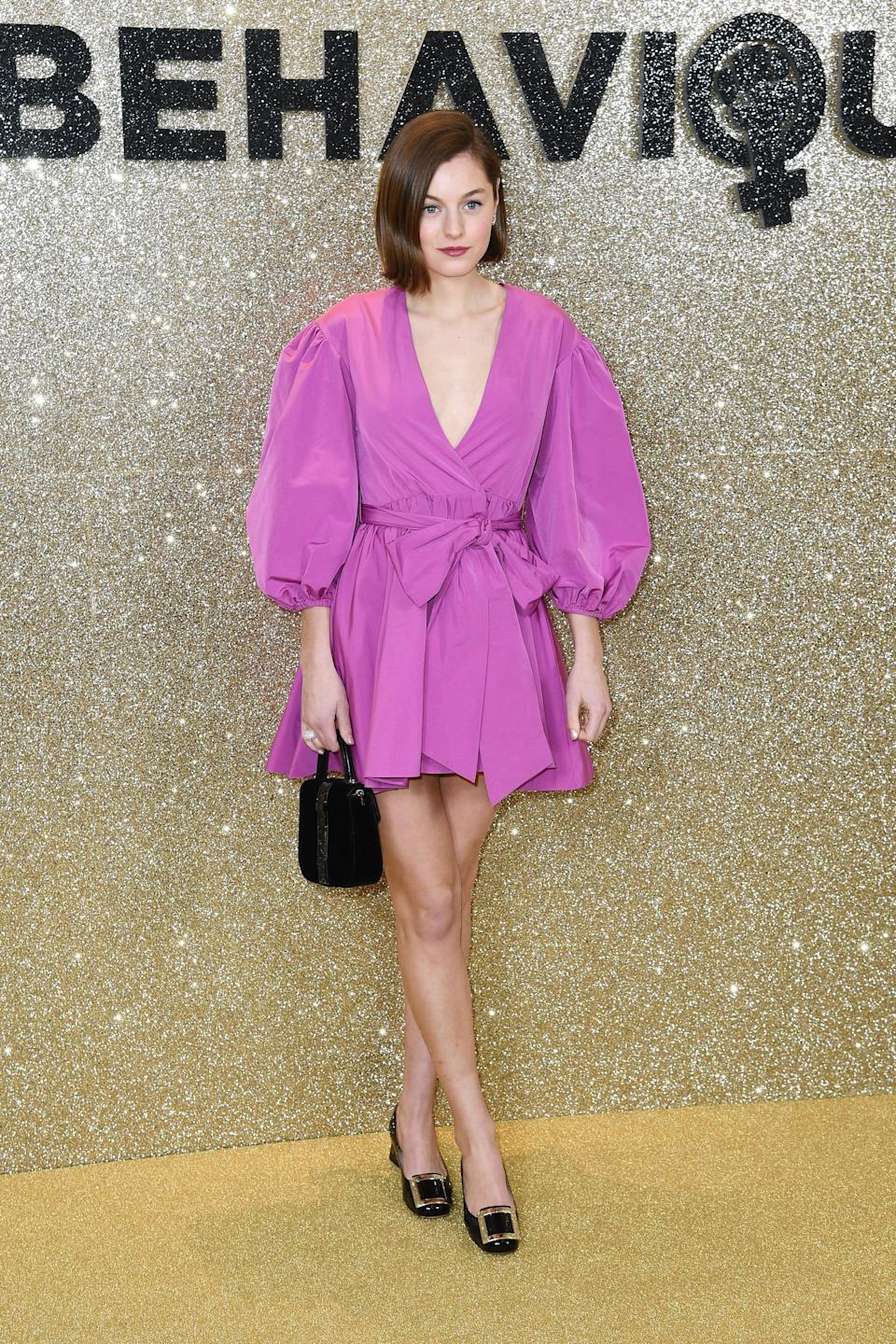 <p>Emma Corrin wore a voluminous fuchsia minidress with puff sleeves to the 2020 premiere of <strong>Misbehaviour</strong>.</p>