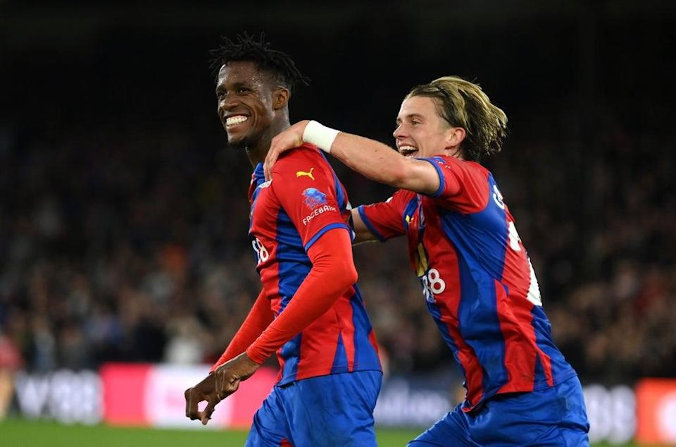 Wilfried Zaha (left) celebrates with Conor Gallagher after giving Crystal Palace the lead (Getty)