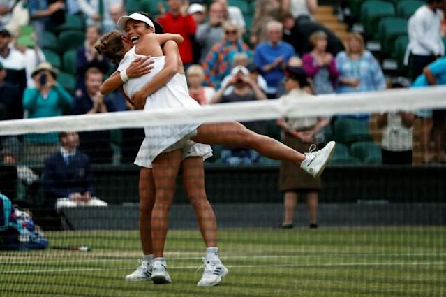 Mine's a double -- Barbora Strycova and Hsieh Su-Wei win women's doubles at Wimbledon (AFP Photo/Adrian DENNIS)