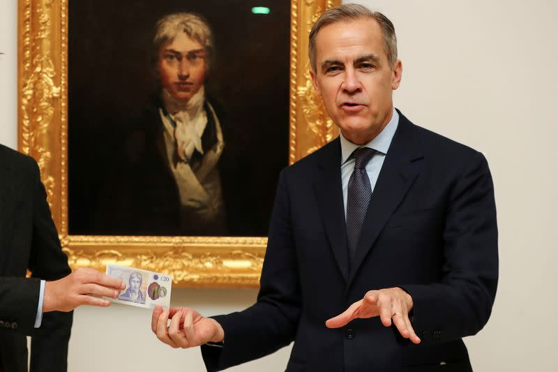 Mark Carney, Governor of the Bank of England poses with  the new 20 pound note featuring artist JW Turner in front of Turner's self portrait at the Tate Britain in London