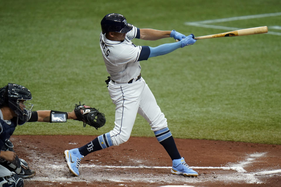 Tampa Bay Rays' Willy Adames lines an RBI double off New York Yankees starting pitcher Corey Kluber during the second inning of a baseball game Friday, April 9, 2021, in St. Petersburg, Fla. Rays' Yandy Diaz scored on the hit. (AP Photo/Chris O'Meara)