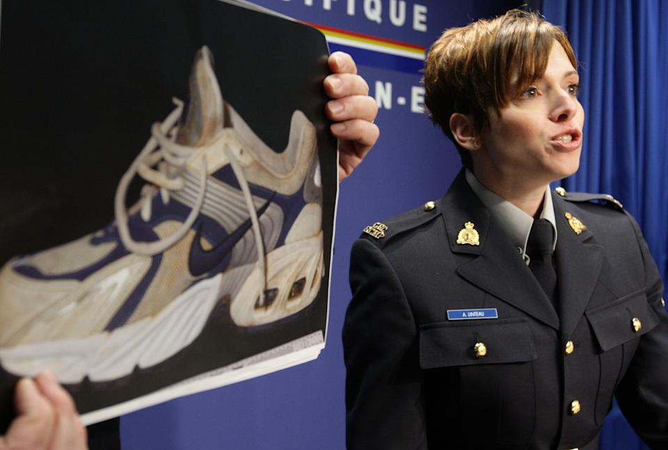 Royal Canadian Mounted Police Constable Annie Linteau, right, speaks as a photograph of a shoe that was on one of five feet that washed up in Canada is displayed. Source: AAP