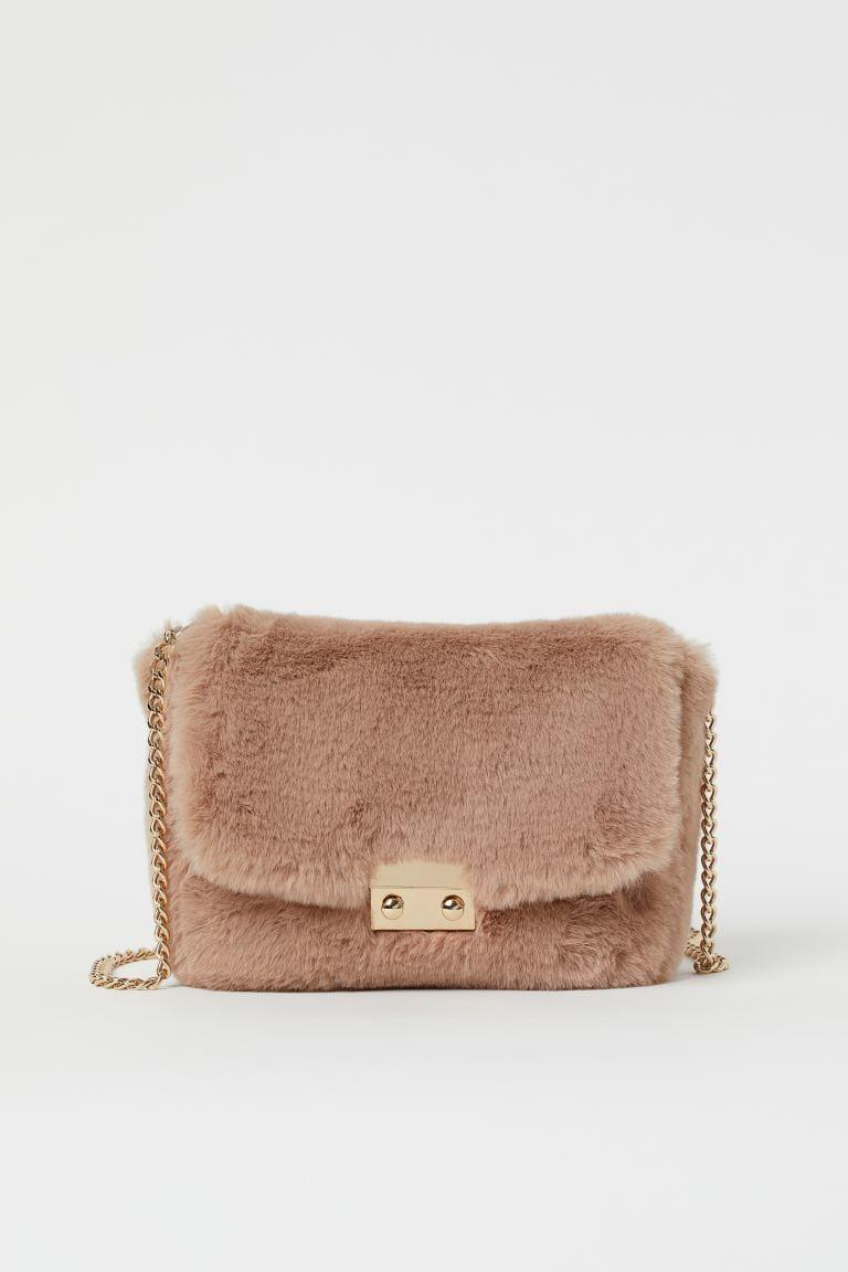 <p>We all know someone who needs this <span>H&M Faux Fur Shoulder Bag</span> ($25).</p>