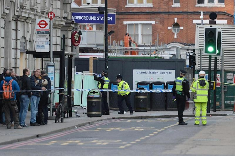 Emergency services outside Victoria Station in central London, where two men were stabbed and taken to hospital (PA)