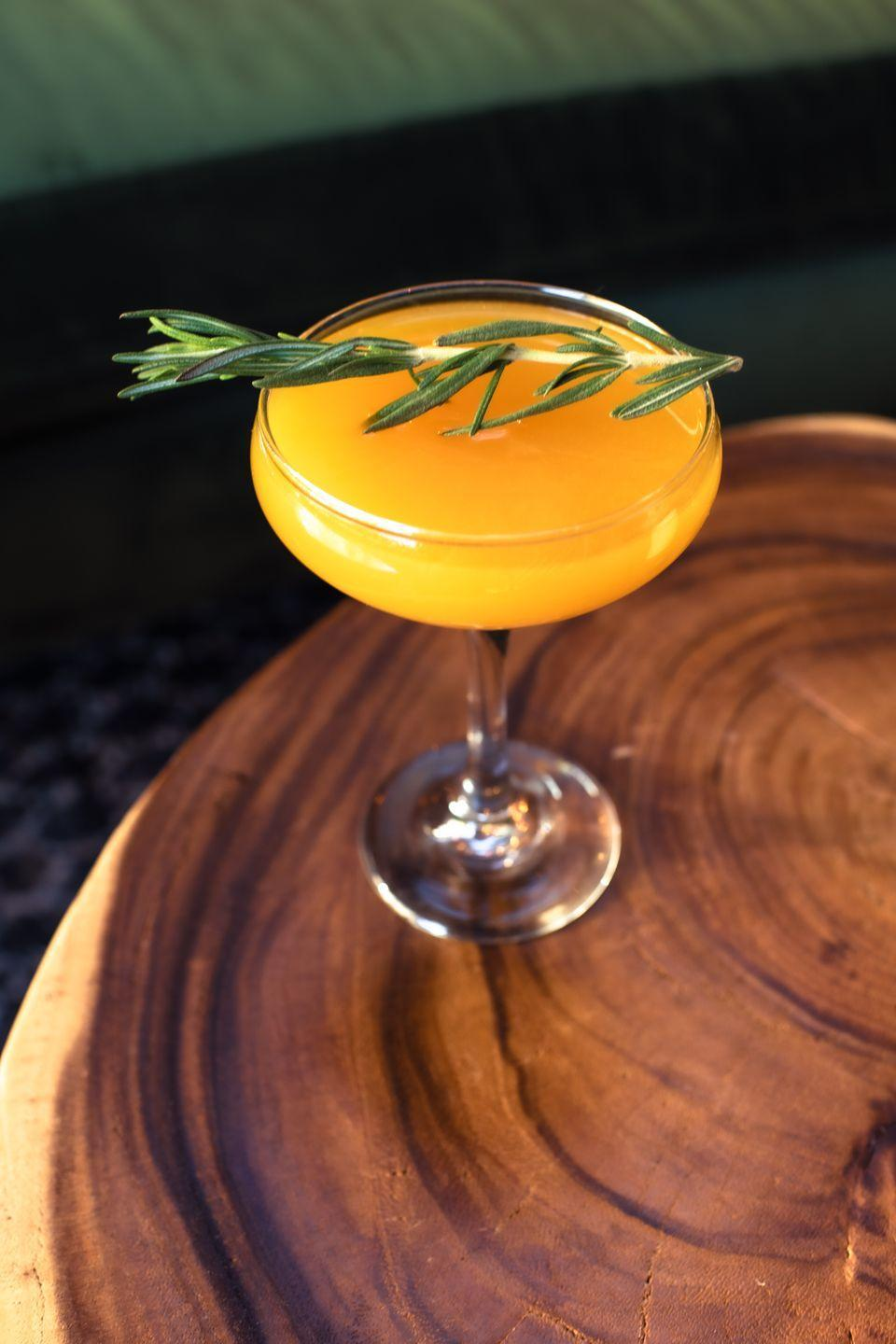 """<p>Created at the Cottontail Lounge at W Scottsdale, this drink not only reflects the name of the bar where it was born, but it also feels reminiscent of a favorite springtime character—Peter Cottontail—and his love of carrots.</p><p><strong>Ingredients:</strong></p><p>2 parts Jack Daniels (or other whiskey of choice)</p><p>1 part Demerara syrup</p><p>3 parts carrot-orange-turmeric juice (we love<a href=""""https://pressedjuicery.com/products/orange-turmeric-apple-lemon-juice"""" rel=""""nofollow noopener"""" target=""""_blank"""" data-ylk=""""slk:Pressed Juicery"""" class=""""link rapid-noclick-resp""""> Pressed Juicery</a>'s option)</p><p>sprig of rosemary, for garnish</p><p>Directions:</p><ol><li>Combine whiskey, Demerara syrup, and juice in a cocktail shaker with ice.</li></ol><p>2. Shake and strain over a coupe glass, garnishing with a sprig of rosemary.</p>"""