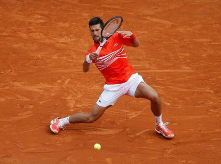 Tennis - ATP 1000 - Monte Carlo Masters - Monte-Carlo Country Club, Roquebrune-Cap-Martin, France - April 16, 2019 Serbia's Novak Djokovic in action during his second round match against Germany's Philipp Kohlschreiber REUTERS/Eric Gaillard
