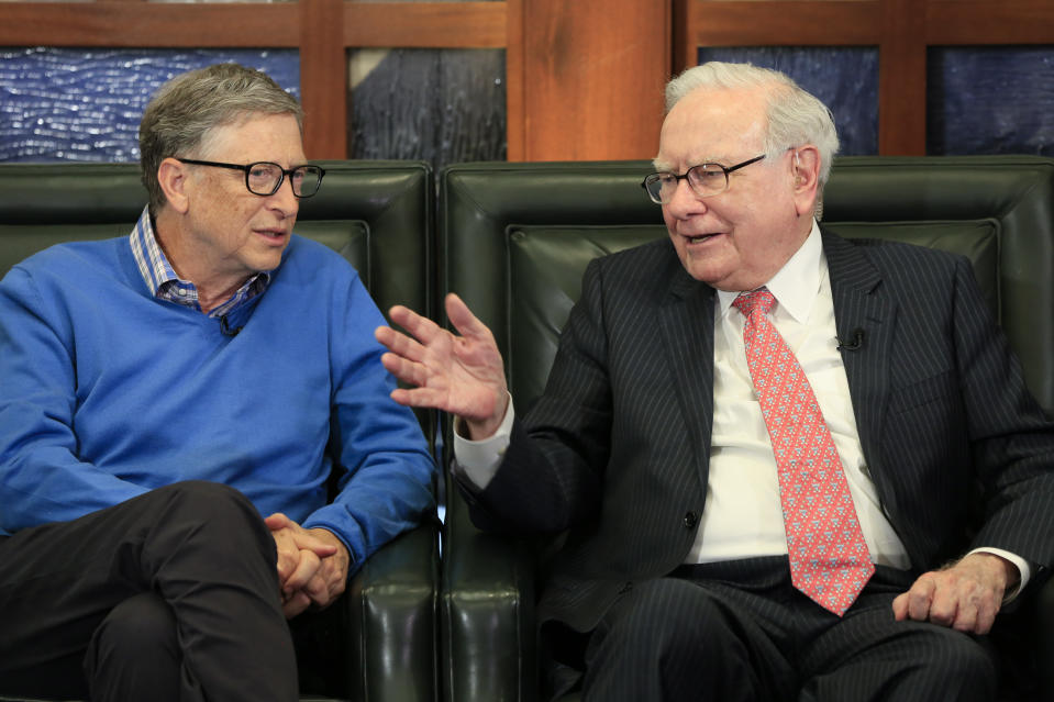 Berkshire Hathaway Chairman and CEO Warren Buffett, right, speaks to Microsoft co-founder and director at Berkshire Hathaway, Bill Gates, as they appear to speak on the Fox Business Network with Liz Claman, in Omaha, Neb., Monday, May 8, 2017. (AP Photo/Nati Harnik)