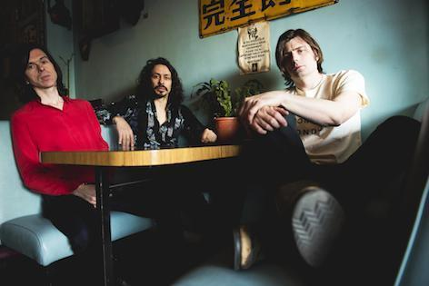 Virgil Howe (centre) has died unexpectedly aged 42