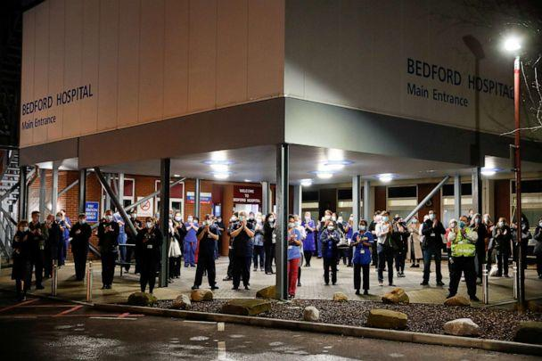 PHOTO: NHS staff participate during a national clap for late Captain Sir Tom Mooreand all NHS workers, amidst the coronavirus disease (COVID-19) outbreak, outside Bedford Hospital, in Bedford, Britain, Feb. 3, 2021. (Matthew Childs/Reuters)