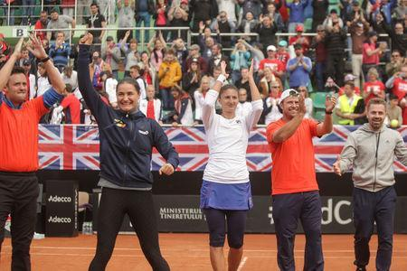 Tennis - Fed Cup World Cup Group II play-off - Romania v Britain - Constanta, Romania - 23/04/17 - Irina Begu celebrates with the Romanian team the win against Britain's team. Inquam Photos/Bogdan Chesaruvia REUTERS