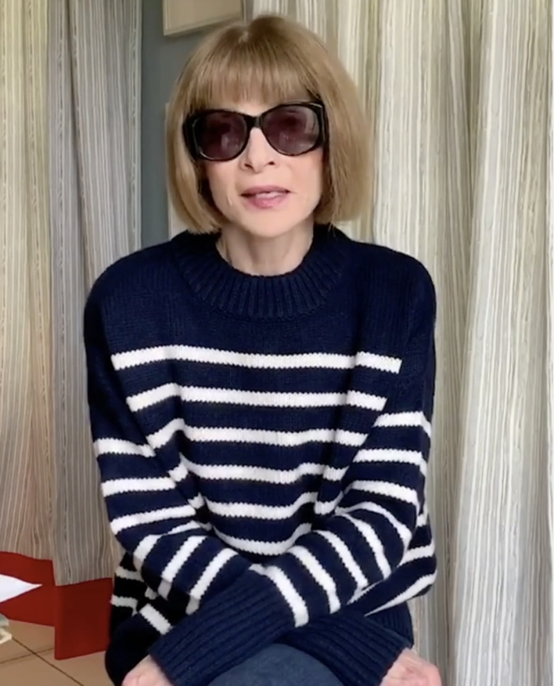 Anna Wintour in a striped top and oversized sunglasses