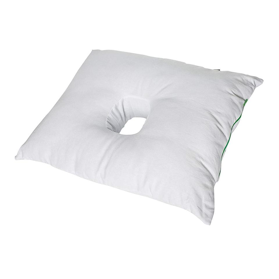 "<p>For many side sleepers, the ear is the biggest barrier when it comes to achieving proper neck alignment; in an attempt to take the pressure off, sleepers will roll forward onto the front of their face, creating a curve in the spine. The Original Pillow With a Hole is here to help stop that, as well as to ease surgery recuperation, painful piercings, and pressure sores. This pillow is wrapped in soft cotton and filled with hollow fiber that you can add or remove depending on your firmness preference. But the real selling point is the center hole that takes all the pressure off your ear.</p> <p><strong>$65</strong> (<a href=""https://www.amazon.com/Original-Pillow-Hole-Your-Friend/dp/B00NCDSINI"" rel=""nofollow noopener"" target=""_blank"" data-ylk=""slk:Shop Now"" class=""link rapid-noclick-resp"">Shop Now</a>)</p>"
