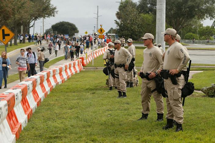 <p>Police monitor the scene at the site of a planned speech by white nationalist Richard Spencer, who popularized the term 'alt-right', at the University of Florida campus on Oct.19, 2017 in Gainesville, Fla. A state of emergency was declared on Monday by Florida Gov. Rick Scott to allow for increased law enforcement due to fears of violence. (Photo: Brian Blanco/Getty Images) </p>