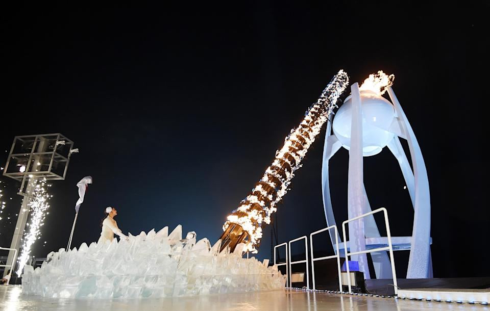 <p>Kim Yu-na, South Korean Figure Skater lights the cauldron during the Opening Ceremony of the PyeongChang 2018 Winter Olympic Games at PyeongChang Olympic Stadium on February 9, 2018 in Pyeongchang-gun, South Korea. (Photo by Pool – Frank Fife/Getty Images) </p>
