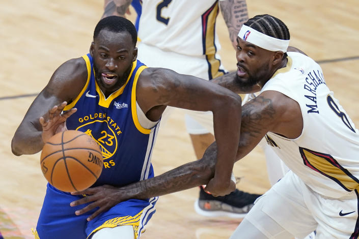 Golden State Warriors guard Nico Mannion (2)3 drives to the basket against New Orleans Pelicans forward Naji Marshall (8) in the first half of an NBA basketball game in New Orleans, Monday, May 3, 2021. (AP Photo/Gerald Herbert)