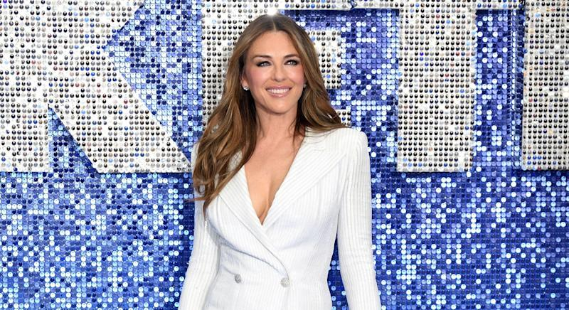 Liz Hurley has been making the most of the sunny weather [Image: Getty]