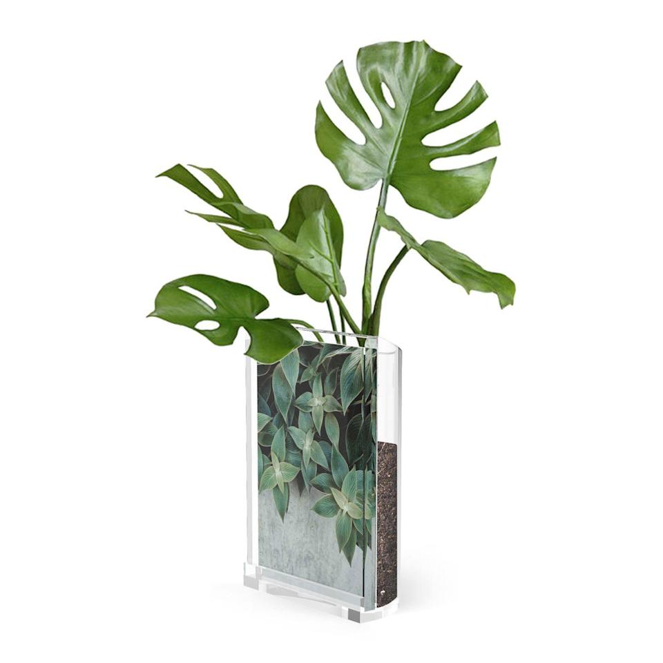 """<p><a rel=""""nofollow noopener"""" href=""""https://www.amara.com/products/optic-4x6-photo-frame-vessel-spruce"""" target=""""_blank"""" data-ylk=""""slk:BUY NOW"""" class=""""link rapid-noclick-resp"""">BUY NOW</a> <strong>Amara, £20</strong></p><p>This photo frame and vessel has a flat surface on one side to hold a single 4x6"""" photo and reverses to a curved open storage space. It's the perfect finishing touch for a shelf or desk.</p>"""